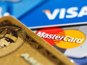 Россиянам с 2014 года крупные покупки придется оплачивать через банки